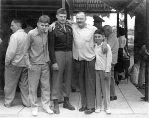 "Hemingway with Patrick, John ""Bumby"", and Gregory ""Gigi""), at Club de Cazadores del Cerro, Cuba. Photograph in Ernest Hemingway Photograph Collection, John F. Kennedy Presidential Library and Museum, Boston."
