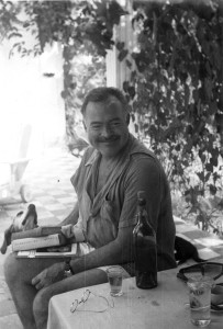 """EH 4449P Ernest Hemingway reading books with his dog Negrita at Finca Vigia in Cuba. Please credit """"Ernest Hemingway Collection/John F. Kennedy Presidential Library and Museum, Boston"""""""